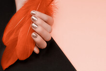 Female Hand With Golden Nail D...