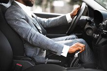Closeup Of Black Man In Suit Changing Gears In Car