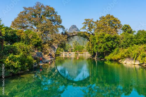 Fototapeta YANGSHUO, CHINA, 6 DECEMBER 2019: Fuli bridge on the Yulong River in the country