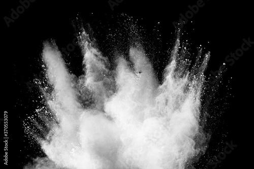 Cuadros en Lienzo Freeze motion of white dust particles splash on black background.