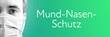 canvas print picture - Mund-Nasen-Schutz. Portrait von Mann mit Mundschutz/Atemmaske. Text auf Hintergund (blau/grün). Coronavirus