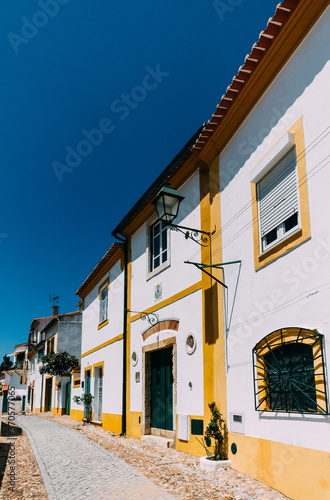 Obraz na plátně Limestone cozy yellow and white houses at Constancia in the Santarem District of