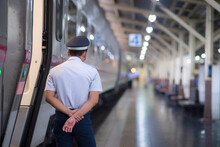 A Security Guard Stands Guard At A Train Station