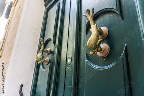 Photo Green Door in Malta with fish handles