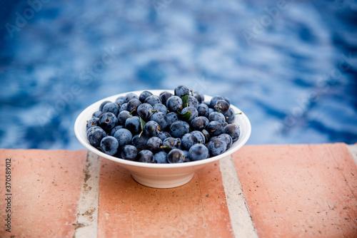 Obraz na plátně blackthorn or sloe blue fruits on bowl
