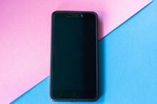 A Black Mobile Phone Lies Scre...