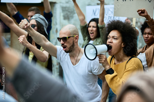 Fotografie, Obraz Crowd of displeased protesters fighting for human rights on public demonstrations