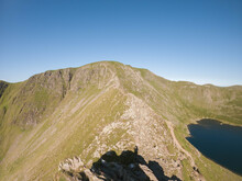 Striding Edge Ridge With The Summit Of Helvellyn Standing Tall Beyond.