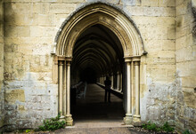 View Through Stone Arch Doorway Of Salisbury Cathedral In England, Horizontal Landscape Orientation.