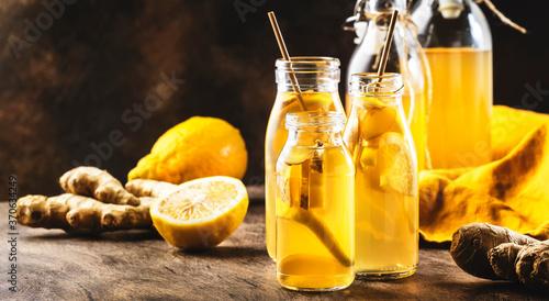 Fototapeta Homemade Fermented Raw Kombucha With Ginger And Lemon.Tea Ready to Drink obraz