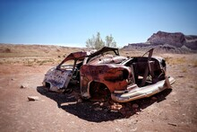 Old Abandoned Car In The Desert