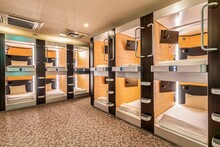 The Two-story Bedroom Area Is Combined Inside A Modern Capsule Hotel In Japan