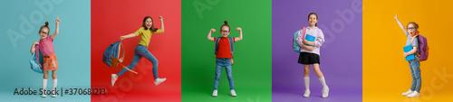 Fototapeta Kids with backpacks on colorful background obraz