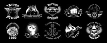 Tattoo Studio Emblems Set. Vintage Logo Templates With Crossed Gun, Rose, Skeleton, Anchor, Diamond, Bike. Monochrome Vector Illustrations Isolated On Black Background