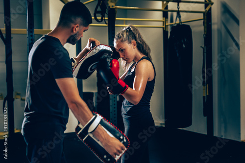 Obraz na plátne woman training kick box with his personal trainer