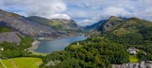 Aerial View Of Dinorwic Quarry, Near Llanberis, Gwynedd, Wales - With Llyn Peris, Llyn Padarn, The Dinorwig Power Station Facilities And Mount Snowdon In The Background