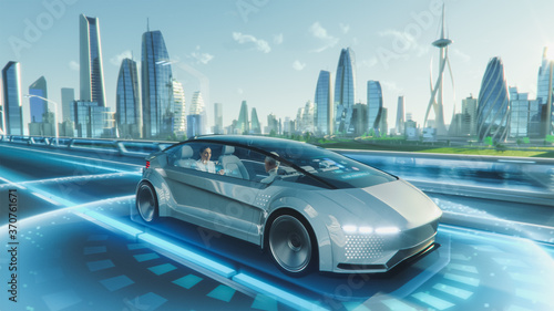 Obraz na plátně Shot of a Futuristic Self-Driving Van Moving on a Public Highway in a Modern City with Glass Skyscrapers