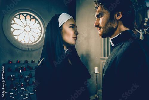 Obraz na płótnie Nun and priest praying and spending time in the monastery