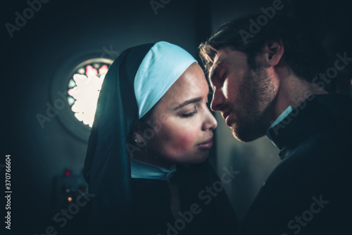 Fotografie, Obraz Nun and priest praying and spending time in the monastery