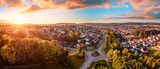 Fototapeta Miasto - Aerial panorama of a European town at sunrise, with magnificent colorful sky and warm light