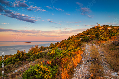 Fototapety, obrazy: Hill with Our Lady Of Loreto Statue near The Primosten town at the colorful dawn of the day, Croatia, Europe.