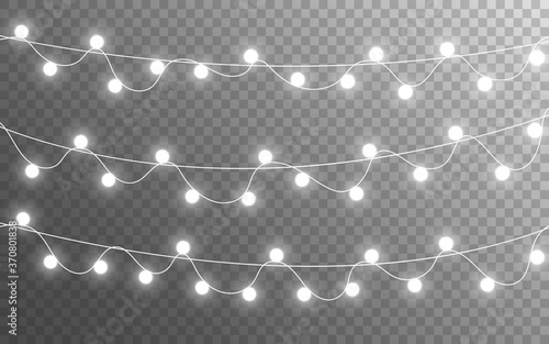 Obraz Christmas lights isolated on transparent backdrop. Glowing silver garland. Bright bulbs decoration. Festive shining elements. Realistic lamps for banner, poster or web. Vector illustration - fototapety do salonu