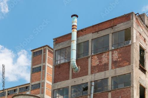 Photo abandoned apartment building. brick texture, fireplace.