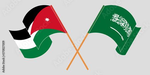 Obraz na plátně Crossed and waving flags of Jordan and the Kingdom of Saudi Arabia