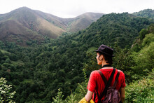 Back View Female Tourist Hiking In Countryside And Admiring Scenery Of Mountainous Valley