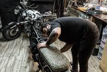 Tattooed Male Biker Standing I...