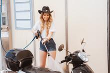 Cheerful Female Rider In Cowbo...