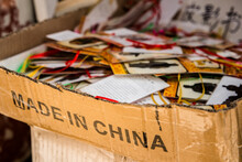 Shabby Cardboard Box With Made In China Inscription Filled With Souvenir Cards In Warehouse