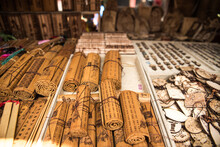 Traditional Bamboo Slips With Hieroglyphs Placed On Counter On Local Bazaar With Souvenirs