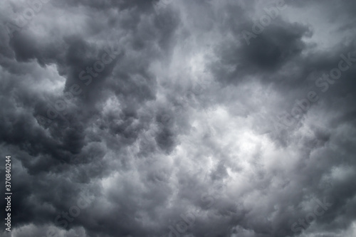 Fototapeta storm clouds in the sky creates a dramatic environment