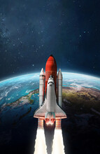 Space Shuttle Launch In Outer Space From Earth. Planet Surface. Rocket On Orbit Of The Planet. Elements Of This Image Furnished By NASA