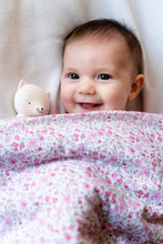 Portrait Of Happy Baby Girl Ly...