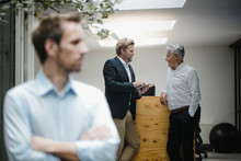 Business People Talking In Office, Businessman Standing In Front, Listening Sceptically