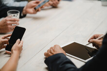 Business People Working In Office Using Portable Devices, Close Up