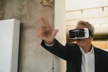 Mature Businessman Wearing VR ...