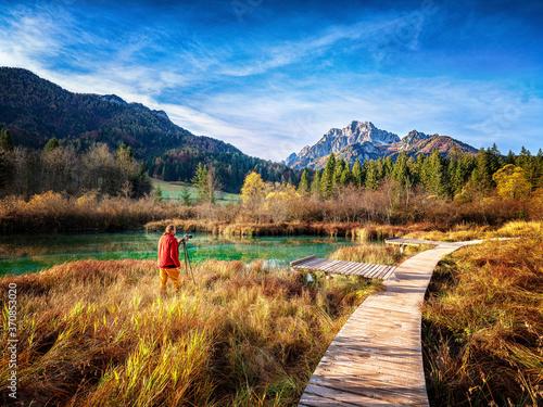 Slovenia, Kranjska Gora, Man photographing scenic landscape of Zelenci Springs
