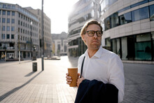 Businessman With Takeaway Coffee In The City