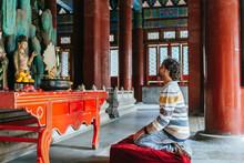 Mid Adult Man Praying In Buddh...