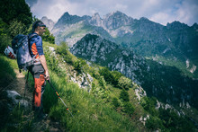 Hiker Standing On Mountain Path Enjoying View, Orobie, European Alps, Como, Italy