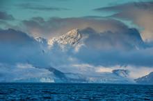 Clouds Shrouding Coastal Mount...