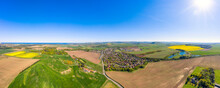 UK, Scotland, East Linton, Aerial Panorama Of Sun Shining Over Countryside Town In Summer
