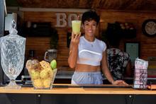 Woman In A Food Truck Offering Cup Of Lemonade