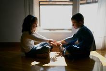 Two Children Put Their Hands T...