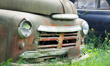 Vintage American Cars Abandoned And Rusting In A Field