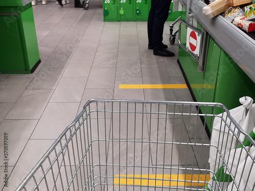 Fototapeta Distance markings signs on the floor in a drugstore, supermarket, shop