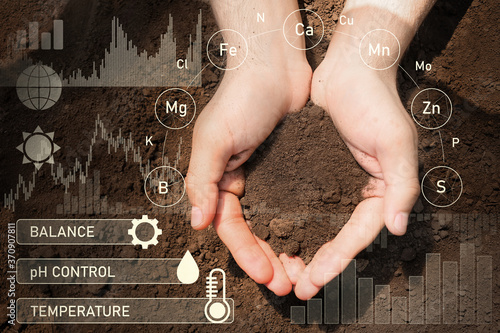 Agronomist with handful of soil outdoors, closeup Canvas Print